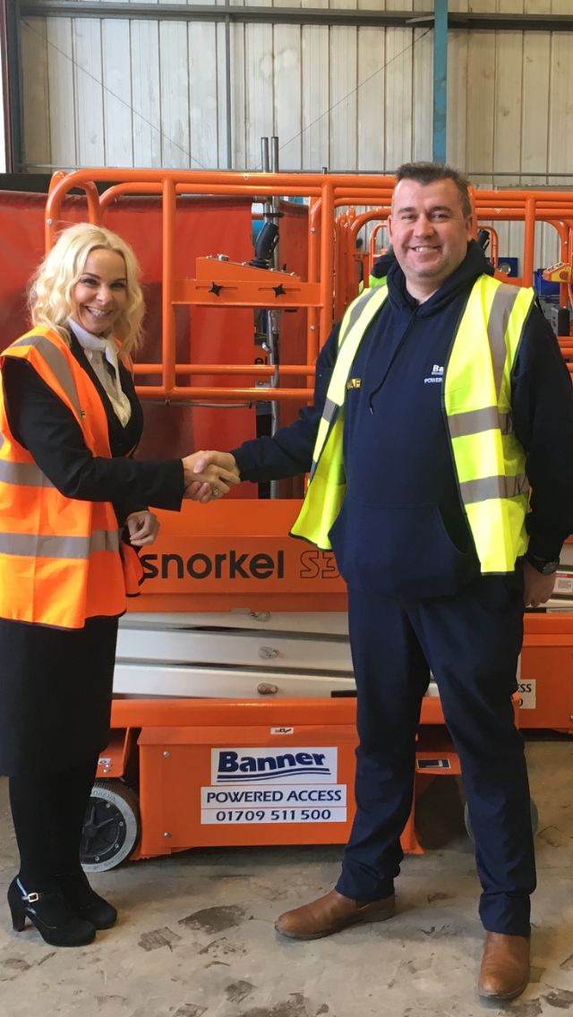 Snorkel UK Sales Director Linda Betts left hands over the Snorkel S3010E to Phil James Depot Manager at Banner Powered Access