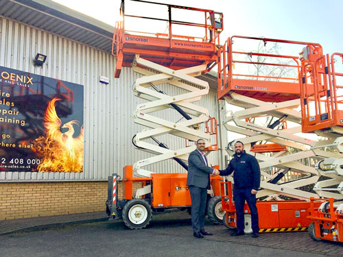 Scott Holtby (right) of Snorkel UK hands over the new lifts to Jason Derraven of Phoenix Hire & Sales.jpg