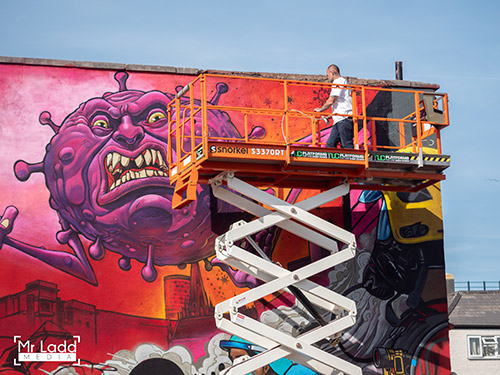 A Snorkel S3370RT supplied by TLC Platforms provided the perfect workspace for the mural creation. Photo courtesy of Edwin Ladd - Mr Ladd Media